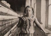 A young spinner at Whitnel Cotton Mill, NC. Iconic photo by Lewis Hine.