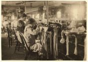 A young girl works as a looper at the Crescent Hosiery Mill in Scotland Neck, NC.